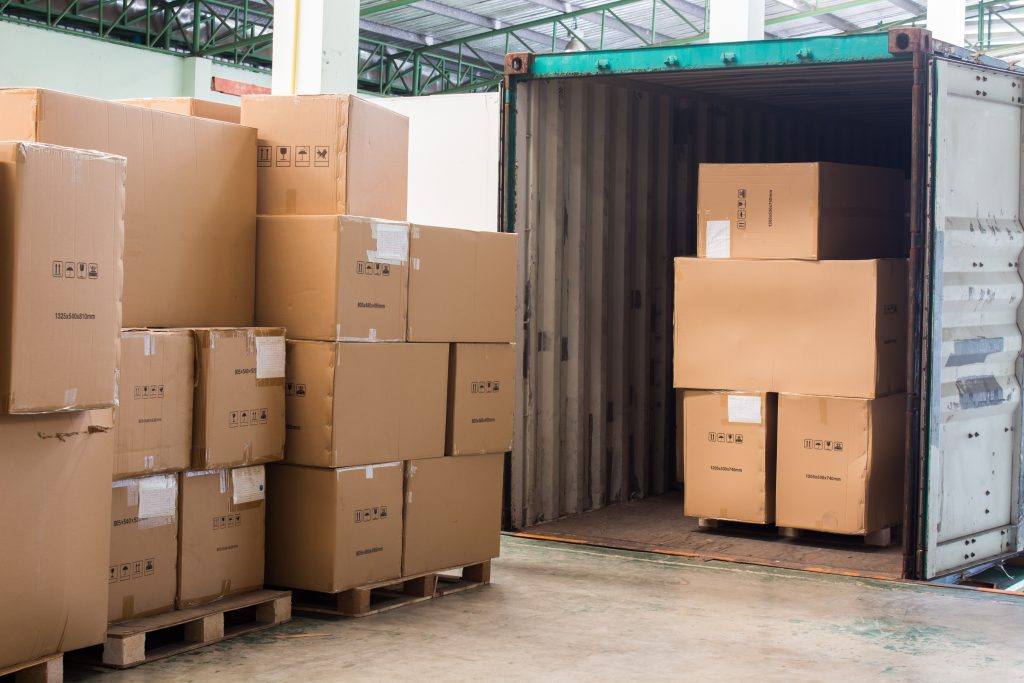 shipping cartons coming out of containers